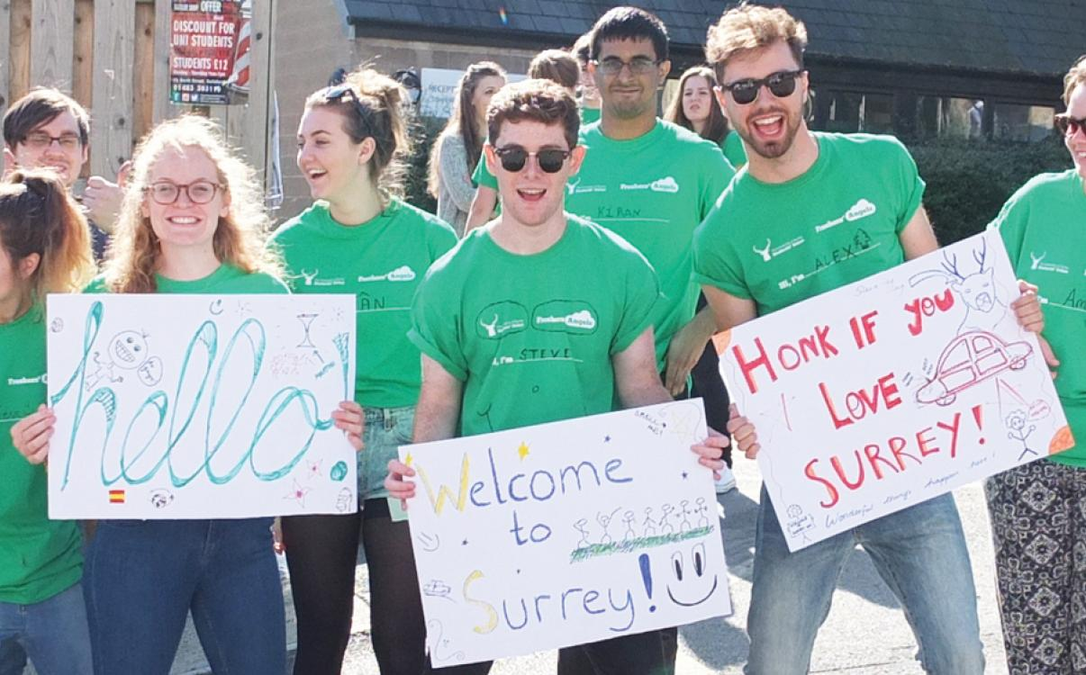 Students with welcome to Surrey signs