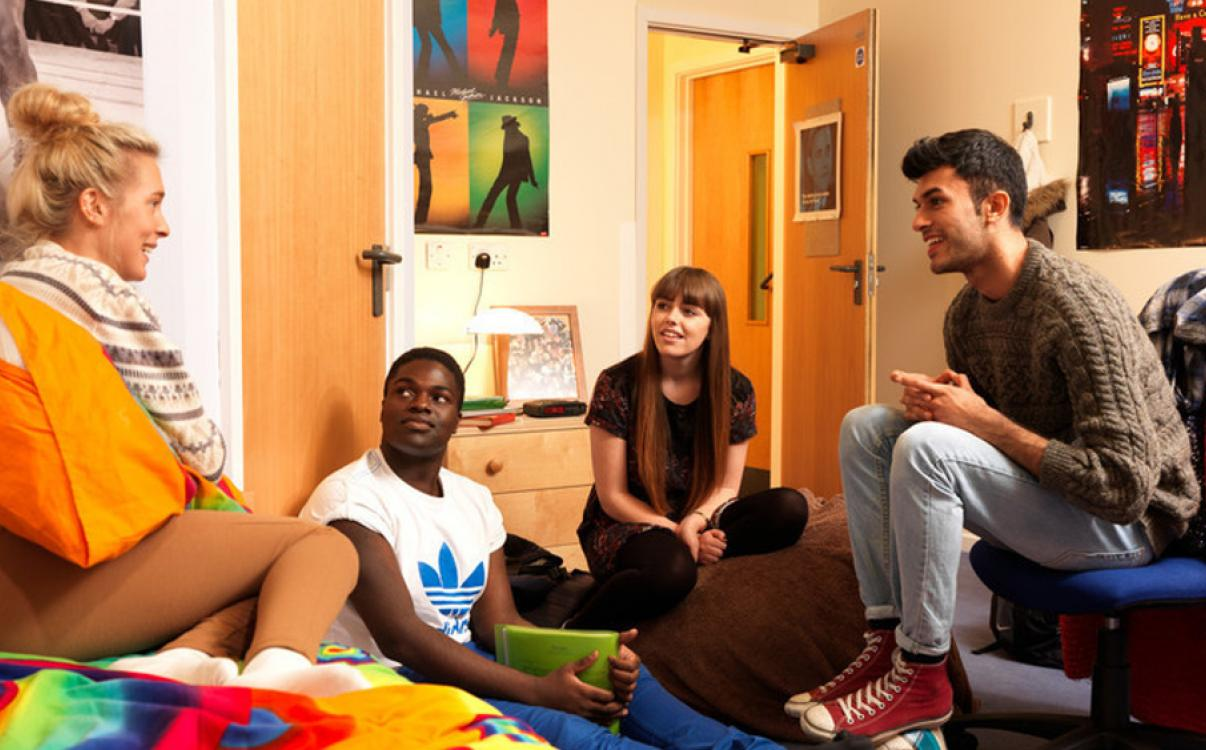 Students in an accommodation bedroom
